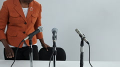 Woman speaking into microphone Stock Footage