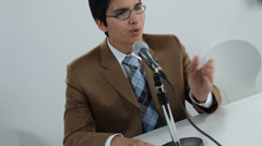 Man speaking into microphone Stock Footage