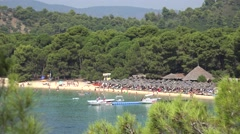 4K Tourist people enjoy famous Koukounaries beach Skiathos Island attraction day Stock Footage