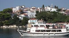 4K Touristic ferry cruise depart sea water excursion Skiathos Island town iconic Stock Footage