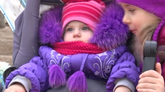 Little Girl Look at her Newborn Sister in  Baby Carriage Stock Footage