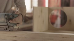 Woodworker process surface of wooden board by belt sander. Smoothing - stock footage
