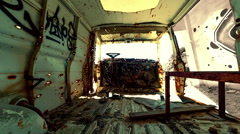 Bullet riddled abandoned van interior timelapse Stock Footage