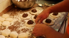 Preparing pies with meat. Flour, dough and meat at background Stock Footage