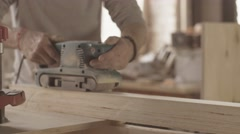 Joiner process of wooden board by belt sander. Move forward and backward Stock Footage