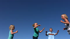 Kids jumping on trampoline, slow motion Stock Footage
