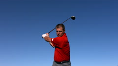 Golfer tees off, slow motion Stock Footage