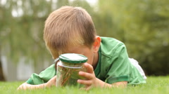Boy with a jar of plants - stock footage