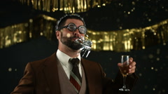 Nerdy man at New Years party, slow motion Stock Footage