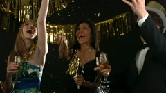 People at New Year's Party cheering and throwing confetti Stock Footage