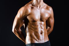 Ripped muscular man in sports concept - stock photo