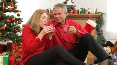 Senior couple drinking from mugs Stock Footage
