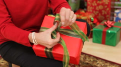 Tying a box on Christmas present Stock Footage