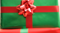 Santa Claus peeks out from behind stack of gifts - stock footage