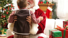 Santa Claus with young boy Stock Footage