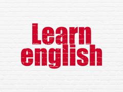 Studying concept: Learn English on wall background Stock Illustration