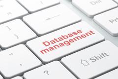 Programming concept: Database Management on computer keyboard background - stock illustration