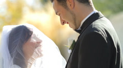Groom lifts veil and kisses bride - stock footage