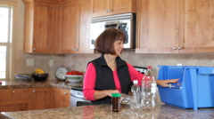 Senior couple in kitchen recycling - stock footage