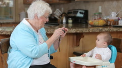 Grandmother taking picture of granddaughter Stock Footage