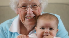 Elderly Great Grandmother with baby Stock Footage