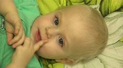 Little Adorable Girl Hiding Face under Blanket. Stock Footage