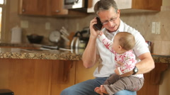 Baby and Grandpa, talking on phone together - stock footage