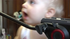 Little Child Discovering Tripod Stock Footage