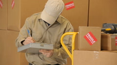 Delivery man working in shipping warehouse Stock Footage