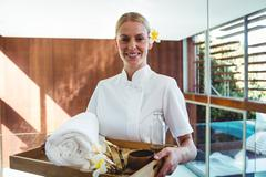 Smiling masseuse holding a tray Stock Photos