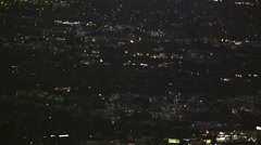 Helicopter flying over night city (GRADED) Stock Footage