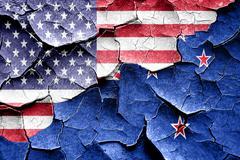 Grunge New zeeland flag with american flag combination Stock Illustration