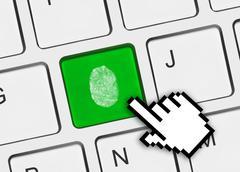 Computer keyboard with fingerprint - stock photo