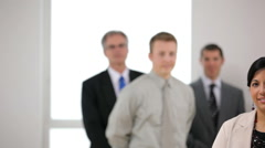 Portrait of business woman with co-workers in background - stock footage