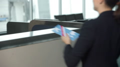 Women checking for flight - stock footage