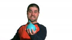 Man hitting water balloon Stock Footage