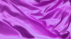 Purple satin fabric blowing in the wind, abstract background - stock footage