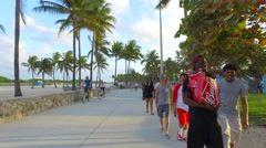People riding electric hoverboards in Miami Stock Footage