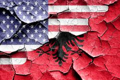 Grunge Albania flag with american flag combination - stock illustration