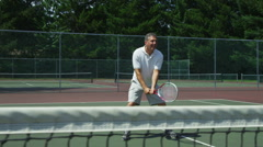 Senior man playing tennis Stock Footage