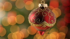 Christmas ornament with blurred lights in background Stock Footage