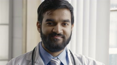 Portrait of a young male doctor, close up Stock Footage