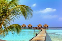 Beautiful water bungalows and the beach in Maldives - stock photo