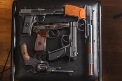 semi-automatic pistols on pixel camouflage background - stock photo