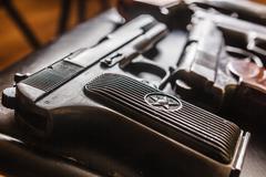Details of semi-automatic pistols - stock photo