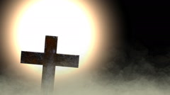 Backlit cross in the ground  fog Stock Footage