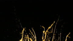 Yellow paint splattering on black background, slow motion - stock footage