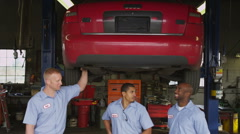 Portrait of three auto mechanics in shop Stock Footage