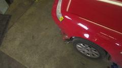 High angle shot of auto mechanic checking car - stock footage
