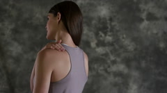 Woman with shoulder pain Stock Footage